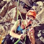 Vanessa setting up her climbing system and get ready for the unknown