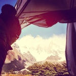 Janet looking at the beautiful peaks after a cold bivy