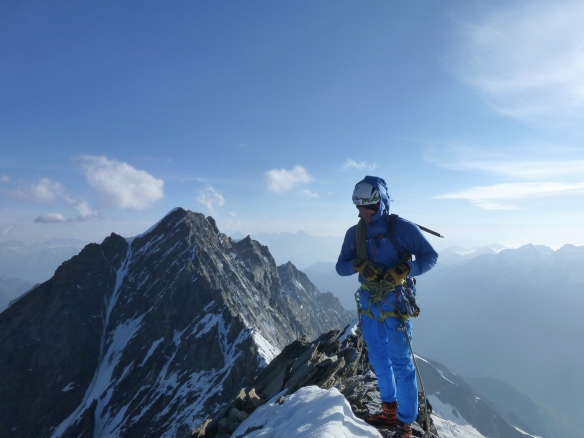 Nils on the windy summit. Behind is the Dom, 4 545m.